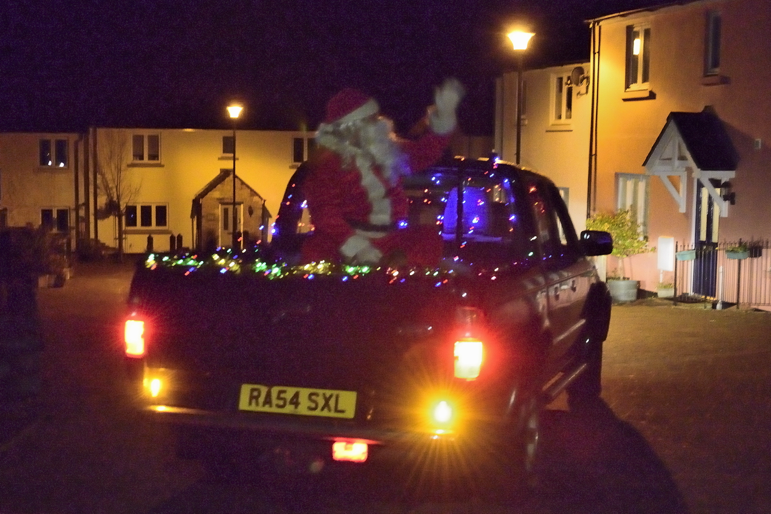 Santa riding in the pickup