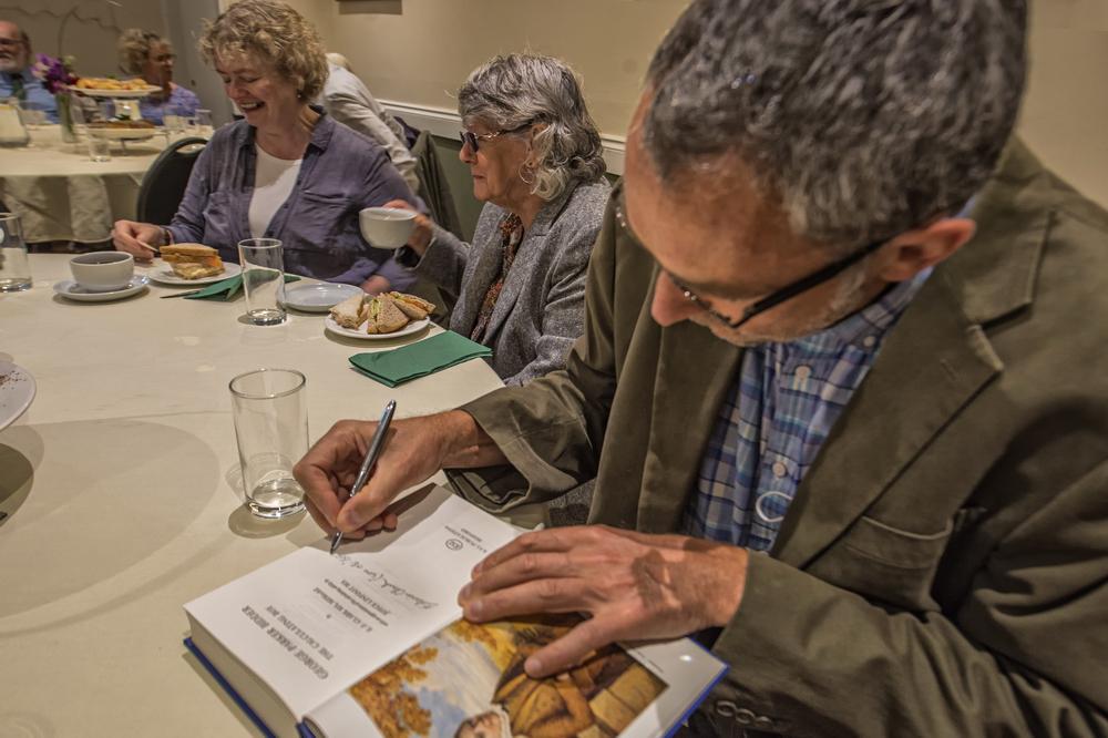 George Bidder descendants signing the book